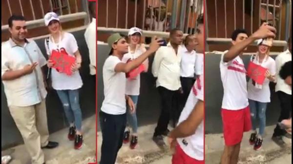 بالفيديو: مصريون يتناوبون لالتقاط صور مع مشجعة مغربية