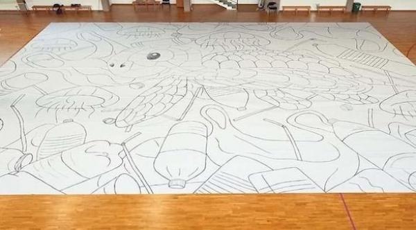 مراهق يحقق رقماً قياسياً عالمياً بعدما أنجز أكبر رسم في العالم