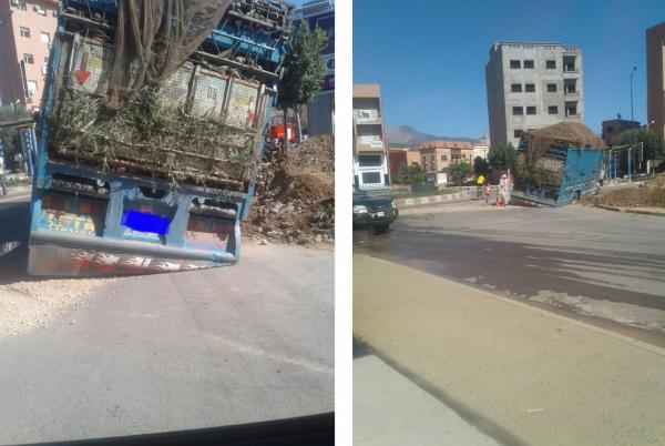 دقائق بعد ترقيع حفرة...  شاحنة لنقل البضائع تسقط فيها وسط استغراب المواطنين