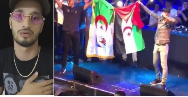 """فيديو: المُغني الجزائري """"سولكينغ"""" يُغضب المغاربة برفع علم """"البوليساريو"""" ويخرج بهذا التوضيح"""