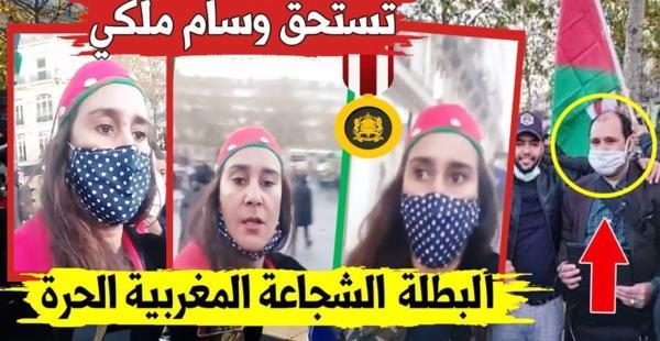 """فايسبوكيون يطالبون بـ""""وسام ملكي""""  للمغربية """"الحرة"""" التي اخترقت بكل """"جرأة"""" تجمعا لـ """"عصابة البوليساريو"""" بباريس (فيديو)"""