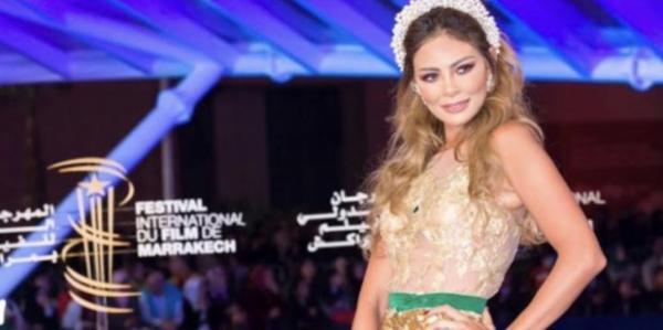 """فنانة مغربية تخلق الحدث  في مهرجان مراكش للفيلم بسبب """"فستانها"""" (صور)"""