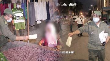 السلطات المحلية تقوم بحملات واسعة بأحد الأحياء الشعبية وتوزع الكمامات على المواطنين