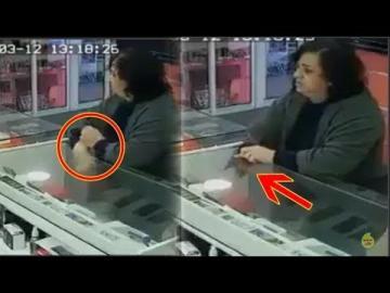 امرأة تسرق بورطابل من احد محلات بيع الهواتف