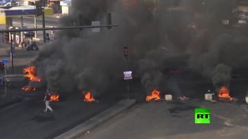 إطلاق نار وسط بيروت ومحتجون يغلقون طرقا رئيسية بالإطارات