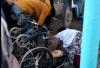 """بالفيديو: شابة تصفع جمركيا بمعبر باب سبتة بسبب """"تعنيف"""" شخص معاق!"""